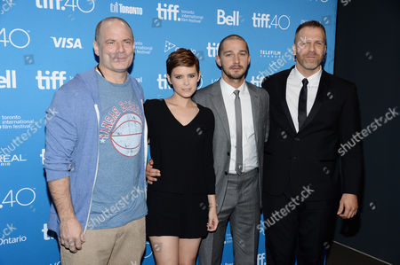 "Director Dito Montiel, from left, Shia LaBeouf, Kate Mara and writer Adam Simon attend a press conference for ""Man Down"" on day 6 of the Toronto International Film Festival at the TIFF Bell Lightbox, in Toronto"