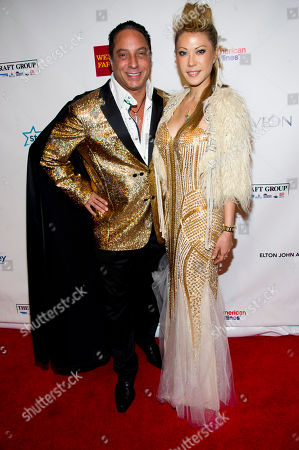 Sir Ivan and Mina Otsuka attend Elton John's AIDS Foundation's 11th annual Enduring Vision benefit on in New York