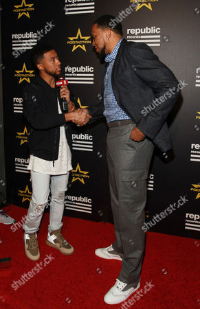 Stock Photo of Lawrence Jackson, left, interviews Shawn Marion at the Republic Records' official GRAMMYs After-Party, sponsored by national footwear and apparel retailer Footaction, at Hyde Sunset Kitchen on in Los Angeles. When it comes to the biggest stars in music and entertainment, style never stops, and Footaction got an exclusive look at how celebs owned their after-party style