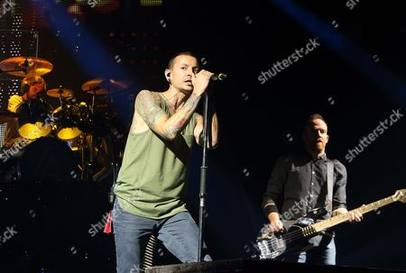 Chester Bennington, from left, and Dave Farrell of the band Linkin Park perform in concert during their Carnivores Tour 2014 at the Susquehanna Bank Center, in Camden, N.J
