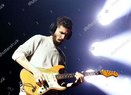 Brad Delson of the band Linkin Park performs in concert during their Carnivores Tour 2014 at the Susquehanna Bank Center, in Camden, N.J