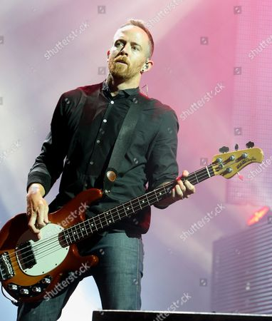 Dave Farrell of the band Linkin Park performs in concert during their Carnivores Tour 2014 at the Susquehanna Bank Center, in Camden, N.J