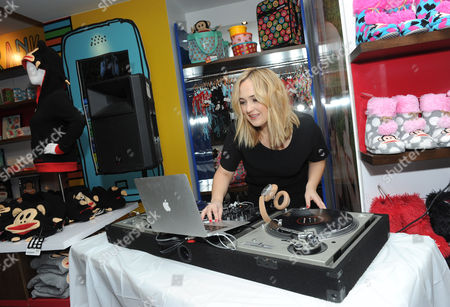 DJ Jilly Hendrix spins beats for fans at the Paul Frank pop-up shop, in New York