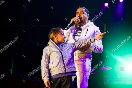 Smokie Norful and his son perform during McDonald's Gospelfest 2013 at the Prudential Center on in Newark, NJ