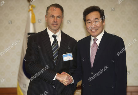 Lee Nak-yon and Devin Wenig