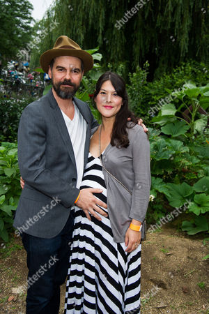 Stock Image of Jeffrey Shagawat and Mizuo Peck attend the Solutions Project garden party at La Plaza Cultural, in New York