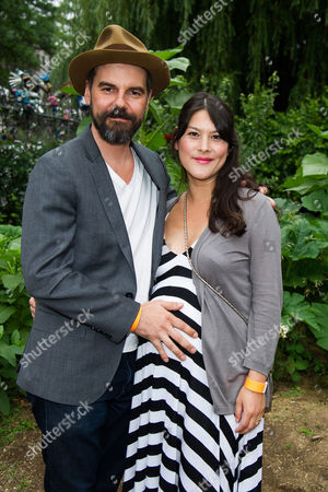 Stock Photo of Jeffrey Shagawat and Mizuo Peck attend the Solutions Project garden party at La Plaza Cultural, in New York