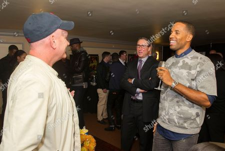 """Mike O'Malley, right talks with Carmi Zlotnik, center and Maverick Carter, at the Starz screening of """"Survivor's Remorse"""" at the Capitol Theater, in Cleveland, Ohio"""