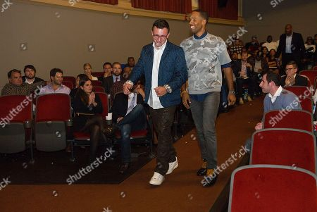 """Johnny Manziel, left and Maverick Carter walk to the stage, at the Starz screening of """"Survivor's Remorse"""" at the Capitol Theater, in Cleveland, Ohio"""