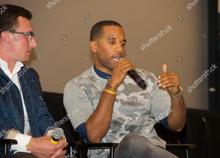"""Maverick Carter, right and Johnny Manziel participate in a question and answer session at the Starz screening of """"Survivor's Remorse"""" at the Capitol Theater, in Cleveland, Ohio"""