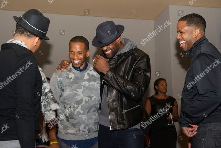 """Maverick Carter, center left, and LeBron James, with hat, joke with friends at the Starz screening of """"Survivor's Remorse"""" at the Capitol Theater, in Cleveland, Ohio"""
