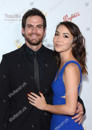 Brent Bailey and Joanna Sotomura arrive at the Television Academy's 67th Emmy IMPG Celebration of Excellence at the Montage Beverly Hills on in Beverly Hills, Calif