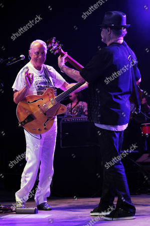 Michael Nesmith and Micky Dolenz of The Monkees perform during the Mid Summers Night Tour at the Mizner Park Amphitheater on in Boca Raton, Florida