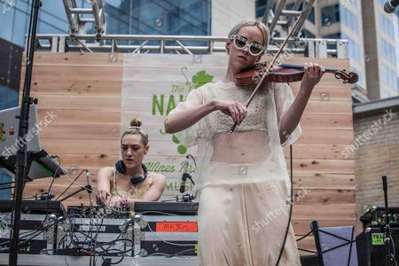 From left, Mia Moretti and Margot Moretti of The Dolls perform at The Naked Grape Wines Presents The Music Box at the Cedar Door during 2014 SXSW on in Austin, Texas