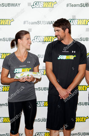 Whitney Phelps, left, is joined by her bother, Olympic swimming champion Michael Phelps, as as she announces that she will run the ING New York City Marathon with Team SUBWAY at the Chelsea Piers Sport Center, in New York