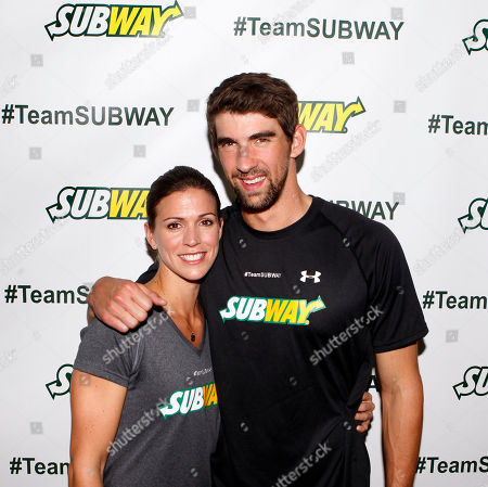 Stock Photo of Whitney Phelps is joined by her brother, Olympic swimming champion Michael Phelps, as as she announces that she will run the ING New York City Marathon with Team SUBWAY at the Chelsea Piers Sport Center, in New York