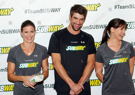Whitney Phelps, left, is joined by her bother, Olympic swimming champion Michael Phelps, and sister Hilary as as she announces that she will run the ING New York City Marathon with Team SUBWAY at the Chelsea Piers Sport Center, in New York