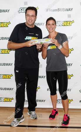 "Former Team SUBWAY marathoner Jared Fogle ""The SUBWAY Guy,"" passes the Footlong baton to Whitney Phelps, sister of Olympic swimming champion Michael Phelps, as Whitney announces that she will run the ING New York City Marathon with Team SUBWAY at the Chelsea Piers Sport Center, in New York"