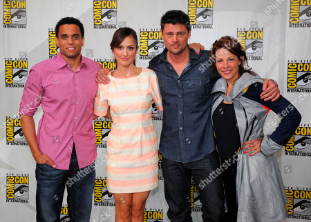 """Almost Human"""" cast members from left, Michael Ealy, Mekia Cox, Karl Urban and Lili Taylor pose after the """"Almost Human"""" panel on Day 3 of 2013 Comic-Con International Convention on in San Diego, Calif"""