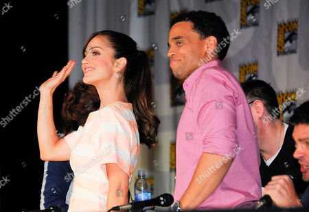 """Mekia Cox, left, and Michael Ealy arrive at the """"Almost Human"""" panel on Day 3 of 2013 Comic-Con International Convention on in San Diego, Calif"""