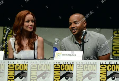 """Lindy Booth, left, and Donald Faison participate in the """"Kick Ass 2"""" panel on Day 3 of Comic-Con International, in San Diego, Calif"""