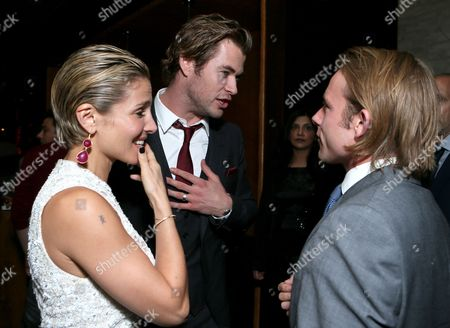 "From left, Elsa Pataky, Chris Hemsworth and Tom Hunt attend Universal Pictures ""RUSH"" premiere after party sponsored by The Hollywood Reporter at The Thompson Hotel on day 4 of the Toronto International Film Festival, in Toronto"