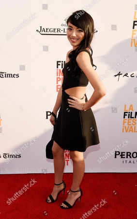 """Montse Hernandez, a cast member in """"Lowriders,"""" poses at the premiere of the film on the opening night of the Los Angeles Film Festival at the Arclight Hollywood, in Los Angeles"""
