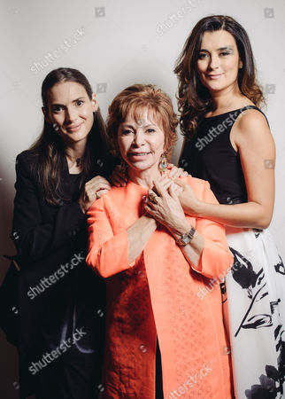 Stock Photo of Winona Ryder, Isabel Allende, and Cote de Pablo pose for a portrait backstage at 26th Annual Literary Awards Festival at the Beverly Wilshire Hotel, in Beverly Hills, Calif