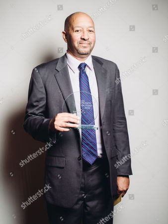 Stock Image of Carl Phillips poses for a portrait backstage at 26th Annual Literary Awards Festival at the Beverly Wilshire Hotel, in Beverly Hills, Calif