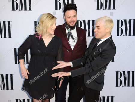Elaine Bradley, from left, Branden Campbell and Tyler Glenn, of Neon Trees, arrive at the 63rd annual BMI Pop Awards at the Beverly Wilshire Hotel, in Beverly Hills, Calif