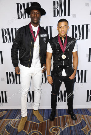 Vinzy V, left, and Nico Sereba, of Nico & Vinz, arrive at the 63rd annual BMI Pop Awards at the Beverly Wilshire Hotel, in Beverly Hills, Calif
