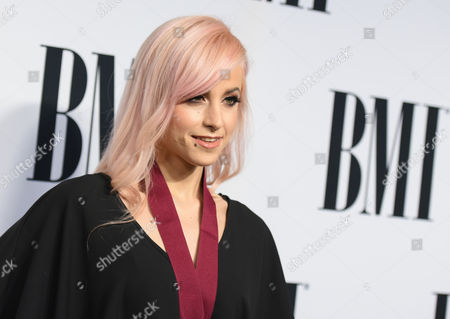 BMI pop award winner Carah Faye Charnow arrives at the 63rd annual BMI Pop Awards at the Beverly Wilshire Hotel, in Beverly Hills, Calif