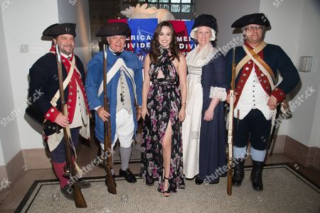 "Heather Lind, center, poses with Revolutionary War re-enactors at a premiere event for AMC's ""Turn: Washington's Spies"" season three at the New York Historical Society, in New York"