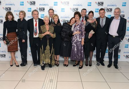 """From left to right, actresses Anna Maxwell Martin and Sophie Kennedy Clark, director Stephen Frears, actress Dame Judi Dench, actor Sean Mahon, producers Tracey Seaward and Gabrielle Tana, Philomena Lee, actor Steve Coogan, Jane Libberton, screenwriter Jeff Pope and author Martin Sixsmith pose together at the American Express Gala Screening of """"Philomena"""" at the Odeon West End during the 57th BFI London Film Festival in partnership with American Express®, in London"""