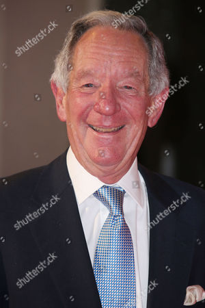 Michael Burke poses for photographers upon arrival at the ITV Gala event in London
