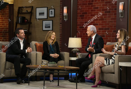 """Stock Image of Butterfinger Cups butt into awards season with special commentators Jason Jones and Samantha Bee as they are interviewed by Steve Edwards and Maria Sansone, left to right, on """"Good Day LA"""" on in Los Angeles. Follow their adventures at ButterfingerCups.com"""