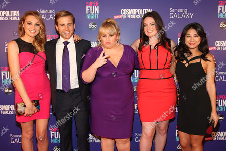 "Stock Picture of Rebel Wilson, center, with her Super Fun Night cast members Kate Jenkinson, Kevin Bishop, Lauren Ash and Liza Lapira attend the Cosmopolitan Hosts ""Super Fun Night"" Premiere at the Joseph Urban Theater at Hearst Tower on in New York"
