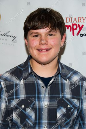"""Actor Robert Capron poses on the red carpet to celebrate the """"Diary of a Wimpy Kid: Dog Days"""" Blu-ray debut on December 18th, at an exclusive screening event held on in New York. Hosted by Twentieth Century Fox Home Entertainment and the Carmelo Anthony Foundation, the family fun event took place at the AMC Empire 25 Theater"""