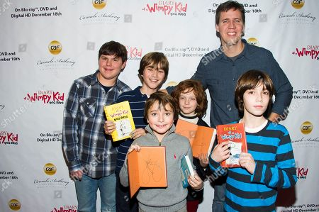 """Diary of A Wimpy Kid author Jeff Kinney and actor Robert Capron pose with fans on the red carpet to celebrate the """"Diary of a Wimpy Kid: Dog Days"""" Blu-ray debut on December 18th, at an exclusive screening event held on in New York. Hosted by Twentieth Century Fox Home Entertainment and the Carmelo Anthony Foundation, the family fun event took place at the AMC Empire 25 Theater"""