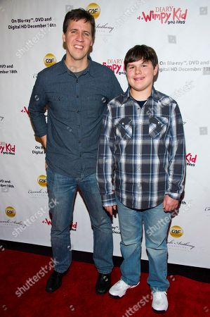 """Stock Picture of Diary of A Wimpy Kid author Jeff Kinney, left, and actor Robert Capron pose on the red carpet to celebrate the """"Diary of a Wimpy Kid: Dog Days"""" Blu-ray debut on December 18th, at an exclusive screening event held on in New York. Hosted by Twentieth Century Fox Home Entertainment and the Carmelo Anthony Foundation, the family fun event took place at the AMC Empire 25 Theater"""