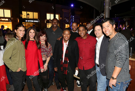 From left, Booboo Stewart, Samantha Harris, Carnie Wilson, Terrell Owens, NFL wide receiver, Kyle Massey, Donald Faison, Christopher Massey, Robert Bonfiglio, Wilson Phillips Producer and Kurt Suzuki, Major League Baseball catcher pose during the Christmas tree lighting ceremony at Fashion Island, in Newport Beach, Calif