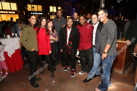 From left, Booboo Stewart, Samantha Harris, Carnie Wilson, Terrell Owens, NFL wide receiver, Disney star Kyle Massey, Donald Faison, Disney star Christopher Massey, Robert Bonfiglio, Wilson Phillips Producer and Kurt Suzuki, Major League Baseball catcher pose during the Christmas tree lighting ceremony at Fashion Island, in Newport Beach, Calif