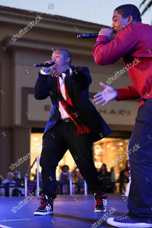 From left, Kyle Massey and Christopher Massey perform during the Christmas tree lighting ceremony at Fashion Island, in Newport Beach, Calif