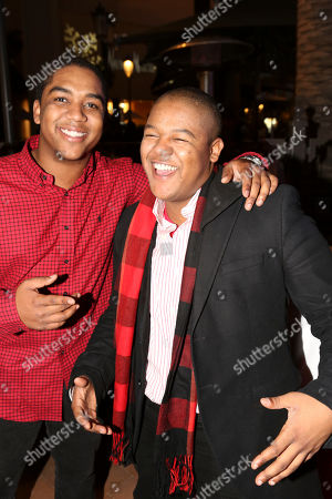 From left, brothers Christopher Massey and Kyle Massey pose during the Christmas tree lighting ceremony at Fashion Island, in Newport Beach, Calif