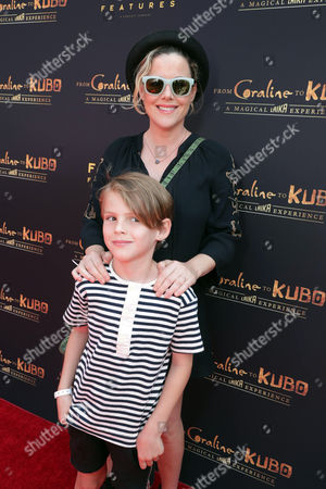 "Kathleen Robertson and William Robert Cowles seen at Focus Features and LAIKA Grand Opening of ""From Coraline to Kubo: A Magical LAIKA Experience"" at The Globe Theatre, in Universal City, CA"