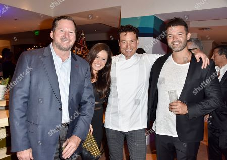 Rocco DiSpirito, third from left, and friends attend the InspIRIE Dinner Gala at the Sherborne Wyndham Grand South Beach, in Miami Beach, Fla