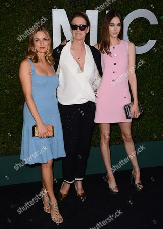 """From left, Nathalie Love, Lisa Love and Laura Love arrive at the Michael Kors launch of Claiborne Swanson Frank's """"Young Hollywood"""" on in Beverly Hills"""