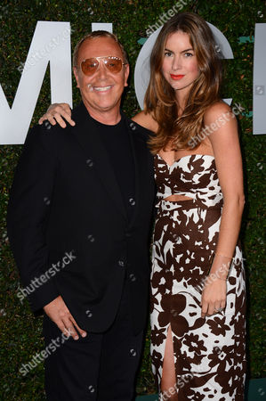"Michael Kors, left, and Claiborne Swanson Frank arrive at the Michael Kors launch of Claiborne Swanson Frank's ""Young Hollywood"" on in Beverly Hills"