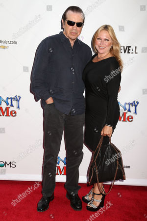 """Actor Chazz Palminteri, left, and his wife Gianna Palminteri attend the premiere of """"Henry & Me"""" at the Ziegfeld Theatre on in New York"""