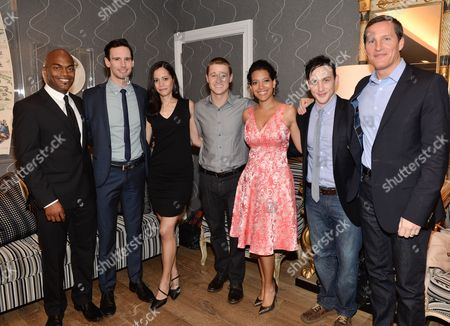 "Cast members, from left, Andrew Stewart-Jones, Cory Michael Smith, Victoria Cartagena, Ben McKenzie, Zabryna Guevara and Robin Taylor pose with FOX COO Joe Earley, right, at a special screening of ""Gotham"" hosted by FOX at the Crosby Street Hotel on in New York"